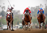 Willa B Awesome, with jockey Martin Pedroza aboard (left) defeats Reneesgotzip with Garrett Gomez (center) and Eden's Moon and Martin Garcia (right) to win the 2012 Santa Anita Oaks at Santa Anita Park in Arcadia California on March 31, 2012.