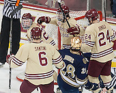 Patrick Brown (BC - 23), Steven Santini (BC - 6), Johnny Gaudreau (BC - 13) and Bill Arnold (BC - 24) celebrate. - The Boston College Eagles defeated the visiting University of Notre Dame Fighting Irish 4-2 to tie their Hockey East quarterfinal matchup at one game each on Saturday, March 15, 2014, at Kelley Rink in Conte Forum in Chestnut Hill, Massachusetts.