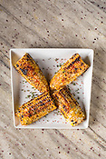 Grilled corn with togarashi miso butter, chives and Korean chili flakes.