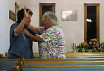 Beulah Pridemore, 60, right, screams in tongues at friend and sister in Christ Faye Sullivan, 72, during a Wednesday night service at Lily Holiness Church, a Pentecostal church in Lily, KY, on October 24, 2012.
