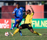 Jason Wright (10) of Jamaica tries to tackle Carlos Valentin (15) of Honduras during the quarterfinals of the CONCACAF Men's Under 17 Championship at Catherine Hall Stadium in Montego Bay, Jamaica. Jamaica defeated Honduras, 2-1.