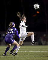"""Boston College forward Brooke Knowlton (16) attempts to control the ball as University of Washington defender Molly Boyd (25) defends. In overtime, Boston College defeated University of Washington, 1-0, in NCAA tournament """"Elite 8"""" match at Newton Soccer Field, Newton, MA, on November 27, 2010."""