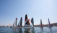 Extreme Sailing Series 2011. Act 3.Turkey . Istanbul.Team Extreme skippered by Roland Gaebler, shown here leading the fleet at the first mark..Credit: Lloyd Images