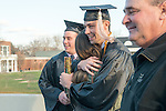 Jake Obrien (Center) gets congratulated by his friends and family following commencement. Photo by Ben Siegel