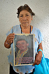 Manuela de Jesus Franco Monteroso, 66, holds a photo of her son Juan Neftali Rodriguez Franco during a vigil in Tapachula, Mexico, on December 17, 2013. The woman was part of a group of Central Americans who came to Mexico in search of family members who disappeared there, many while on their way north to the United States. The group, mostly mothers looking for their children, spent 17 days touring 14 Mexican states in search of their loved ones.<br /> <br /> Franco, from Guatemala City, last heard from her son on August 18, 2010, when he called her just before attempting to cross the border from Mexico into the United States.