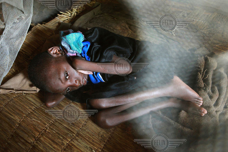 15 year old Muburo Rusange is disabled and can't stretch her legs and arms. Her mother calls her her bat because she is so small and always sits in a collapsed position. A community based rehabilitation program of Handicap International is now taking care of the family.