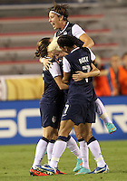 BOCA RATON, FL - DECEMBER 15, 2012: Megan Rapinoe (15) of the USA WNT withRachel Buehler (16), Shannon Boxx (7) and Abby Wambach (14) after scoring against China WNT during an international friendly match at FAU Stadium, in Boca Raton, Florida, on Saturday, December 15, 2012. USA won 4-1.