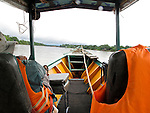 A view from a small boat on the Tambopata River outside of Puerto Maldonado Peru