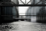 The city of warehouses in Hamburg abstract. with a man who crosses a bridge.