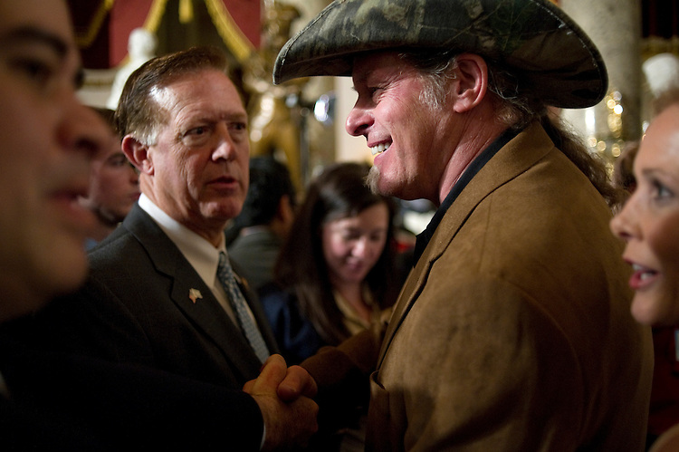 UNITED STATES - FEBRUARY 12:  Rep. Randy Weber, R-Tex. greets musician Ted Nugent after U.S. President Barack Obama's State of the Union address at the Capitol. (Photo by Chris Maddaloni/CQ Roll Call)