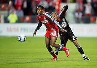 16 April 2011: D.C. United midfielder/forward Fred #27 and Toronto FC defender Danleigh Borman #25 in action during an MLS game between D.C. United and the Toronto FC at BMO Field in Toronto, Ontario Canada..D.C. United won 3-0.