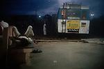 At the bus stand at dusk, Dwarka, Gujarat