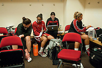 FRESNO, CA--Teammates Sarah Boothe and Alex Green review notes while intern Liz Rizza and Grace Mashore tend to pre-practice duties at the Save Mart Center for the 2012 NCAA Championships.
