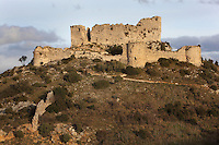 "Aguilar Castle, Chateau d'Aguilar, Cathar Castle, Tuchan, Corbieres, Aude, France. The castle consists of an inner keep built in the 12th century, surrounded by an outer pentagonal fortification from the 13th century with semi-circular guard towers, and is one of the ""Five Sons of Carcassonne"" or ""cinq fils de Carcassonne"". It is a listed monument historique. Picture by Manuel Cohen"