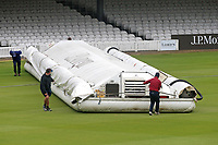 Ground staff bring on the hover cover as rain interrupts play during Middlesex CCC vs Essex CCC, Specsavers County Championship Division 1 Cricket at Lord's Cricket Ground on 24th April 2017