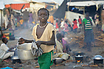 A displaced girl carries food inside a United Nations base in Malakal, South Sudan. More than 20,000 civilians have lived inside the base since shortly after the country's civil war broke out in December, 2013, but renewed fighting in 2015 drove another 5,000 people into the safety of the camp.