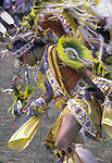 "Native American at pow wow wearing regalia hand made for Fancy dance contest at the Eastcoast Thunderbird Powwow in Queens NY ....A pow-wow (also powwow or pow wow or pau wau) is a gathering of North America's Native people. The word derives from the Narragansett word powwaw, meaning ""spiritual leader""."