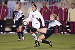 3 November 2006: Wake Forest's Laura Colven (24) stretches a leg past Florida State's Libby Gianeskis (12) to get a boot on the ball. Florida State defeated Wake Forest 4-2 in penalty kicks after playing to a 0-0 draw after overtime at SAS Soccer Park in Cary, North Carolina in an Atlantic Coast Conference women's college soccer tournament semifinal game.