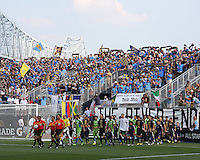 Teams enter the stadium with the Commodore Barry bridge in the background during the first MLS match at PPL stadium in Chester, Pa. on June 27 2010. Union won 3-1.