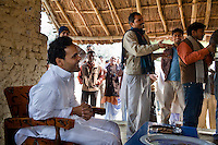 Minister of Legislative Assembly, Ritesh Pandey, 30, enjoys the poetry of a local as he has lunch with villagers after campaigning door-to-door in a Dalit (the lowest Hindu caste) village in Ajanpara, Ambedkar Nagar, Uttar Pradesh, India, on 21st January, 2012. Returning 1.5 years ago after almost 10 years abroad, Pandey is contesting on behalf of the Bahujan Samaj Party (BSP), a party that is based on its appeal to Dalit voters. Party leader Mayawati, herself a Dalit, has recently been giving out more tickets to muslims and high caste candidates in an attempt to woo a larger spectrum of voters in Uttar Pradesh, a Bellwether state. Photo by Suzanne Lee for The National (online byline: Photo by Szu for The National)
