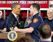 United States President Barack Obama thanks Lieutenant Jacob Johnson, an Arlington County firefighter and US Marine Corps veteran who served in Iraq who introduced him, prior to making remarks on the economy at Fire Station #5 in Arlington, Virginia on Friday, February 3, 2012.  .Credit: Ron Sachs / Pool via CNP