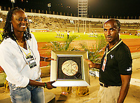 Grace Jackson accepting a Special Award from Donald Quarrie at the Jamaica International Invitational Meet on Saturday, May 2nd. 2009. Photo by Errol Anderson, The Sporting Image.net