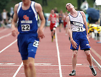 Gibbon's Dillon Eckel, right, reacts to being passed up near the finish line by Gordon-Rushville's Cole Wellnitz, left, in the 3200 meter run at the 2011 NSAA state track and field championships at Omaha Burke Stadium. (Independent/Crystal LoGiudice)..
