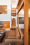 Exposed wood beams and posts between living room and dining room of a contemporary home. This image is available through an alternate architectural stock image agency, Collinstock located here: http://www.collinstock.com