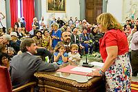 Roma 21 Maggio 2015<br /> Celebration Day, l&rsquo;inaugurazione del registro delle unioni civili in Campidoglio. Sono 17 le coppie che si sono presentate per l&rsquo;iscrizione: coppie omosessuali ed eterosessuali che dopo anni di convivenza  festeggiano con lo scambio degli anelli, la cerimonia si &egrave; svolta nella sala della Protomoteca di Palazzo Senatorio. Una coppia di uomini gay con tre figli.<br /> Rome May 21, 2015<br /> Celebration Day, the opening of the register of civil unions in the Capitol. Are 17 couples that have occurred for registration: homosexual and heterosexual couples who, after years of living together celebrate with the exchange of rings, the ceremony was held in the hall of Protomoteca Palazzo Senatorio. Same-sex couple Dario De Gregorio and Andrea Rubera during the ceremony their children to register their civil union at Rome's city hall on May 21, 2015 in Rome.