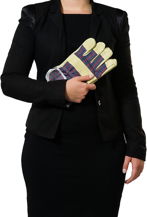 businesswoman ready to put on some gloves to do the dirty work