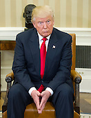 United States President-elect Donald Trump listens as US Barack Obama makes remarks to the media pool in the Oval Office of the White House in Washington, DC on November 10, 2016.<br /> Credit: Ron Sachs / CNP<br /> (RESTRICTION: NO New York or New Jersey Newspapers or newspapers within a 75 mile radius of New York City)