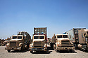 Equipment and logistics convoys destined for remaining tactical hubs across the U.S. Forces Iraqi Theater line up to depart from Joint Base Balad August 27, 2010.  The U.S. Army's 103rd Expeditionary Sustainment Comand at Balad is one of two large scale logisitics centers in Iraq responsible for helping move supplies and equipment to support the remaining just under 50,000 remaining U.S. Forces in Iraq.   .Slug: Iraq
