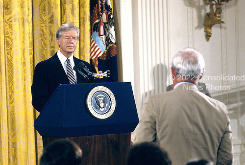 United States President Jimmy Carter listens to a reporter's question as he holds a press conference in the East Room of the White House in Washington, DC on August 4, 1980.  The President discussed the scandal surrounding his brother Billy.  Carter said there was no impropriety in his brother's activities and insisted neither he nor any member of his administration broke any laws.  The President went on to say his brother tried to free the American hostages being held in Iran through his dealings with the Libyans.<br /> Credit: Benjamin E. &quot;Gene&quot; Forte / CNP