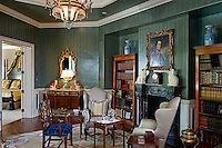 Master Suite sitting room is European estate inspired with painted emerald green<br /> moire walls patterned walls and wool tartan upholstery in the wainscoting below