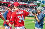 22 September 2013: Washington Nationals Manager Davey Johnson is met by Bryce Harper and photographed by team photographer Mitch Layton prior to a game against the Miami Marlins at Nationals Park in Washington, DC. The Marlins defeated the Nationals 4-2 in the first game of their day/night double-header. Mandatory Credit: Ed Wolfstein Photo *** RAW (NEF) Image File Available ***