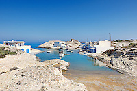 """Traditional fishermen houses with the impressive boat shelters, also known as """"syrmata"""" in Agios Konstantinos of Milos, Greece"""