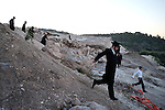 Ultra-Orthodox Jewish men tour a construction site of a new neighborhood, during a protest against it, in the town of Ramat Beit Shemesh. They claim the designated construction area is full of ancient burial caves.