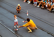 Orlando, Florida - Circa 1986. Child plays with Disney World performer in Main Street after Mickey's Street Party (held between January 1985 - 1986). Disney World is a world-renowned entertainment complex that opened October 1, 1971 in Lake Buena Vista, FL. Now known as the Walt Disney World Resort, the property covers 25,000 acres and has an annual attendance of 52.5million people.