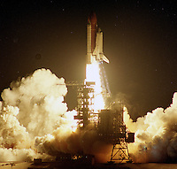 Space Shuttle Atlantis rises into the night sky from  launch Pad 39-A at Kennedy Space Center to begin its November 1991 launch on the STS-44 mission. Crew: Frederick D. Gregory, Commander; Terence T. Hendricks, Pilot; Mario Runco, Jr., Mission Specialist; James S Voss, Mission Specialist; F. Story Musgrave, Mission Specialist; and Thomas J. Hennen, Payload Specialist. (Photo by Brin Cleary/www.bcpix.com)