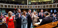 TALLAHASSEE, FLA. 11/18/14-ORGSESS111814CH-Senators Tom Lee, R-Brandon, joined by his wife Circuit Judge Laurel Moore Lee, left, Lizbeth Benacquisto, R-Fort Myers, Bill Galvano, R-Bradenton, Nancy Detert, R-Venice, and Jeff Brandes, R-St. Petersburg, take the oath of office from Florida Supreme Court Chief Justice Jorge Labarga during Organizational Session, Nov. 18, 2014 at the Capitol in Tallahassee.<br /> <br /> COLIN HACKLEY PHOTO