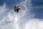 01 October 2005, Liencres, Spain --- Professional surfer Pablo Solar of Spain in action at the Liencres beach, on northern Spain. Photo by Victor Fraile --- Image by © Victor Fraile/Corbis