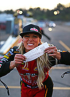 Feb 11, 2017; Pomona, CA, USA; NHRA top fuel driver Leah Pritchett celebrates with her time slip after qualifying number one for the Winternationals at Auto Club Raceway at Pomona. Mandatory Credit: Mark J. Rebilas-USA TODAY Sports