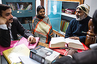 Brinda (center) is coached by the Guria legal team in preparation for her final witness court appearance in the Guria office in Varanasi, Uttar Pradesh, India on 22 November 2013. She is one of the 57 underaged and trafficked girls rescued from the Shivdaspur red light area in Varanasi, who has been fighting a court case against her traffickers and brothel owners for the past 8 years.