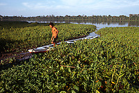 Native Guide on Boat on a lake off the Rio Yarapa; Amazonia, Peru