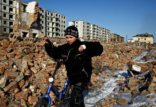 Sergei, 10, cycles in the abandoned military garrison town Mirnaya, 160 km from the Russian border with China. Russia pulled out its army after a border agreement was reached in 2004 with China. The local economy, which has depended on the military, plunged.