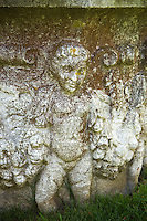 angel statues on an urn
