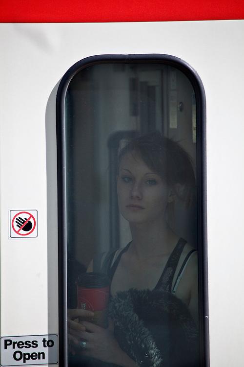 "Women rides the ""CTrain"" or Calgary's light rail train in Calgary, Alberta Canada"