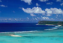 Tumon Bay with sandy islet and reef, Two Lovers Point in distance; Guam, Micronesia.