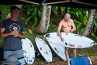 PIPELINE, Oahu, Hawaii (Tuesday, December 10, 2013) Darren Handley (AUS) and Mick Fanning (AUS).   - The 2013 Billabong Pipe Masters in Memory of Andy Irons resumed today in six foot (2 metre) barrels and there was no shortage of drama in the ASP World Title race between Mick Fanning (AUS), 32, and Kelly Slater (USA), 41. There was also a shift in the Vans Triple Crown of Surfing Rankings as well as qualification developments for the 2014 WCT.<br /> <br /> The Billabong Pipe Masters represents the pinnacle of the 2013 ASP World Championship Tour, deciding the ASP World Title, Vans Triple Crown of Surfing, and final slots for 2014 ASP WCT qualification.<br /> <br /> Mick Fanning, two-time ASP World Champion and current No. 1, dominated his Round 3 clash with wildcard Kaimana Jaquias (HAW), 20, but unexpectedly erred in his three-man Round 4 heat against John John Florence (HAW), 21, and Nat Young (USA), 22. A last minute paddle battle with heat leader Florence in the closing seconds of the match took him from second to third and now pits him against one of the best Pipeline surfers in the world: C.J. Hobgood (USA), 34, in Round 5. Meanwhile, Slater skips Round 5 and heads straight to the Quarterfinals after his Round 4 win.<br /> <br /> Clearly disappointed with his misstep, Fanning couldn&rsquo;t leave the beach fast enough and wasn&rsquo;t prepared to talk about how this affects his approach to the final day of competition.<br /> <br /> Kelly Slater was electric in his bid for a historic 12th ASP World Title, earning the high heat-totals of both Round 3 and 4. Slater tore past Mitch Crews (AUS), 23, with a 17.66 out of 20 heat total for incredible Pipeline and Backdoor barrels and backed up the performance with a 17.50 out of 20 in Round 4.<br /> Photo: joliphotos.com