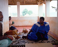 The late Modjadji IV who died in 2001, during an audience with a baLodebu subject at her palace. Her secretary Victor Matecha at left.  1989. Greg Marinovich